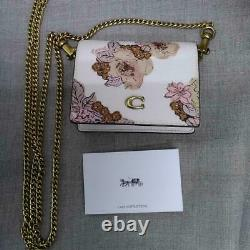 Coach wallet compact chain wallet white floral pattern fashionable beautiful